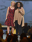 MIAMI, FL - OCTOBER 25: Author Elizabeth Gilbert and  Oprah Winfrey onstage at Oprahs The Life You Want Weekend at American Airlines Arena on Saturday October 25, 2014 in Miami, Florida. (Photo by Johnny Louis/jlnphotography.com)