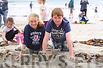 Enjoying the Childrens Beach Treasure Hunt  at  the Ballyheigue Summer Festival week on Monday were Tara Foley and Barry Scanlon