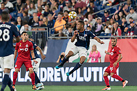 FOXBOROUGH, MA - AUGUST 31: Brandon Bye #15 of New England Revolution heads the ball during a game between Toronto FC and New England Revolution at Gillette Stadium on August 31, 2019 in Foxborough, Massachusetts.