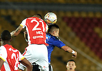 BOGOTA - COLOMBIA -14 -03-2015: Fernando Uribe (Der.) jugador de Millonarios disputa el balón con Francisco Meza (Izq.) jugador de Independiente Santa Fe, durante partido entre Millonarios e Independiente Santa Fe por la fecha 10 de la Liga Aguila I-2015, jugado en el estadio Nemesio Camacho El Campin de la ciudad de Bogota. / Fernando Uribe (R) player of Millonarios vies for the ball with Francisco Meza (L) player of Independiente Santa Fe, during a match between Millonarios and Independiente Santa Fe, for the  date 10 of the Liga Aguila I-2015 at the Nemesio Camacho El Campin Stadium in Bogota city, Photo: VizzorImage / Luis Ramirez / Staff.