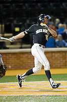 Charlie Morgan (24) of the Wake Forest Demon Deacons follows through on his swing against the North Carolina Tar Heels at Wake Forest Baseball Park on March 9, 2013 in Winston-Salem, North Carolina.  The Tar Heels defeated the Demon Deacons 20-6.  (Brian Westerholt/Four Seam Images)