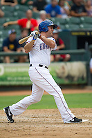 Round Rock Express designated hitter Lance Berkman (12) follows through on his swing during the Pacific Coast League baseball game against the Salt Lake Bees on August 10, 2013 at the Dell Diamond in Round Rock, Texas. Round Rock defeated Salt Lake 9-6. (Andrew Woolley/Four Seam Images)