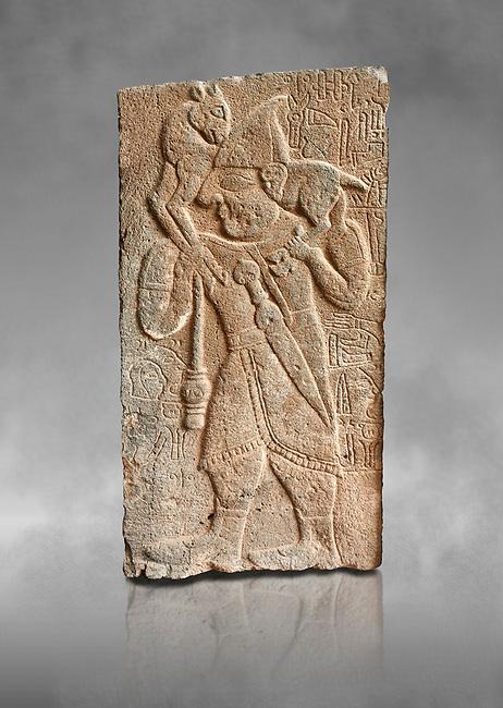 Pictures & images of the North Gate Hittite sculpture stele depicting Hittite man with a sheep on his shoulders. 8th century BC. Karatepe Aslantas Open-Air Museum (Karatepe-Aslantaş Açık Hava Müzesi), Osmaniye Province, Turkey. Against grey art background