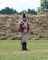 Firing a musket, Fort George, Niagara-on-the-Lake, red coat soldier, at attention