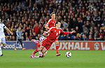 UEFA European Championship at Cardiff City Stadium - Wales v Cyprus : <br /> Gareth Bale of Wales is tackled by Marios Nikolaou of Cyprus.