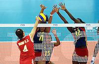 REPUBLICA CHECA. 25-06-2013. La selección Colombia sub 20 de voleibol femenino perdió su compromiso de hoy frente a China por marcador de 3-0 en  el Campeonato Mundial de la categoría, que se disputa en Brno, República Checa. En la imagen la colombiana Danna Escobar (C) e Ivonne Daniela Montaño (D) bloquean el ataque de la china Fengjiao Wang (I)./ Colombian team lost today the match against China by score of 3-0 in 2013 Women's Under 20 World Championship Tournament at Brno, Czech Repuiblic. In the picture colombian player Danna Escobar (C) and Ivonne Daniela Montano (R) blocks asgainst China Fengjiao Wang spikes. Photo: VizzorImage / FIVB/ COURTESY/ NO SALES/ EDITORIAL ESU ONLY