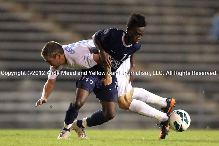 02 October 2012: Georgia Southern's Eric Dinka (12) gets tangled up with UNC's Martin Murphy (behind). The University of North Carolina Tar Heels defeated the Georgia Southern Eagles 2-0 at Fetzer Field in Chapel Hill, North Carolina in a 2012 NCAA Division I Men's Soccer game.