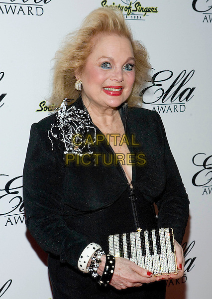 CAROL CONNOR.The 18th Annual Ella Awards held at the Beverly Hilton Hotel, Beverly Hills, CA, USA..May 18th, 2009.half length black jacket bracelets piano keys keyboard clutch bag .CAP/ADM/TC.©T. Conrad/AdMedia/Capital Pictures.