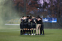 WINSTON-SALEM, NC - DECEMBER 07: The Wake Forest University Starting XI huddles with head coach Bobby Muuss during a game between UC Santa Barbara and Wake Forest at W. Dennie Spry Stadium on December 07, 2019 in Winston-Salem, North Carolina.
