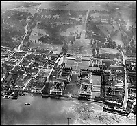 BNPS.co.uk (01202 558833)<br /> Pic: Aerofilms/HistoricEngland/BNPS<br /> <br /> Royal Naval College, Greenwich, 1946.<br /> <br /> Stunning historic aerial photos of seaside towns, naval bases, ports and shipyards which tell the story of Britain's once-great maritime tradition feature in a new book.<br /> <br /> The fascinating archive of black and white images includes views from a bygone age such as Brighton's famous West Pier, Grimsby's burgeoning fishing fleet, and London's dock yards.<br /> <br /> Iconic ships were also captured from the skies including the Cutty Sark in its final seaworthy years on the Thames, HMY Britannia in 1959, the RMS Queen Mary in 1946 and the SS Queen Elizabeth in 1969 about to make her maiden voyage.<br /> <br /> England's Maritime Heritage from the Air, by Peter Waller, is published by English Heritage and costs &pound;35.