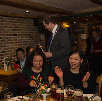Matthew Walsh, Town Mayor & Chairman, Princes Risborough Town Council, (Peter Zhang is next to him laughing) at a party with members of the Chinese-UK Business Alliance in The Plough at Cadsden, Buckinghamshire. SinoFortone Group bought the pub after it was visited by Chinese Premiere Ji Jinping last year, and aim to develop  a chain of English-style pubs China.<br /> <br /> Photo by Richard Jones