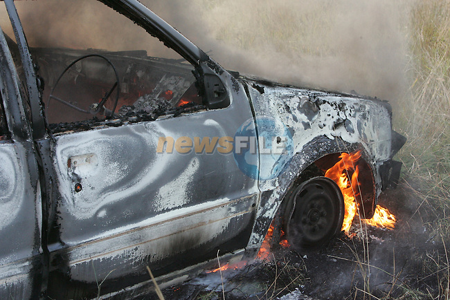 The remains of a burning nissan micra in the bryanstown area of Drogheda.Photo: Fran Caffrey/ Newsfile.