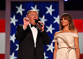 United States President Donald Trump with First Lady Melania Trump speaks to supporters at the Liberty Ball at the Washington Convention Center on January 20, 2017 in Washington, D.C. Trump will attend a series of balls to cap his Inauguration day.     <br /> Credit: Kevin Dietsch / Pool via CNP