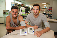 ASDA Old Mill Lane's new pharmacy has opened, two of the first visitors taking advantage of a free blood pressure check were Mansfield Town players Ryan Tafazolli (left) and Andy Owens. Pharmacy manager AJ is pictured at the counter.