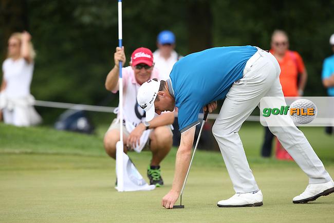 Finding the line with caddie Gerry Byrne, Michael Hoey (NIR) during Round Three of the 2015 BMW International Open at Golfclub Munchen Eichenried, Eichenried, Munich, Germany. 27/06/2015. Picture David Lloyd | www.golffile.ie