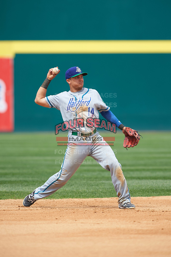 Hartford Yard Goats second baseman Anthony Phillips (14) warmup throw to first base during a game against the Binghamton Rumble Ponies on July 9, 2017 at NYSEG Stadium in Binghamton, New York.  Hartford defeated Binghamton 7-3.  (Mike Janes/Four Seam Images)