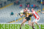 Dr Crokes Eoin Brosnan gets to grip with the ball under pressure from Rathmore's Conor O'Sullivan during their Senior Club Championship semi final clash in Fitzgerald Stadium on Saturday