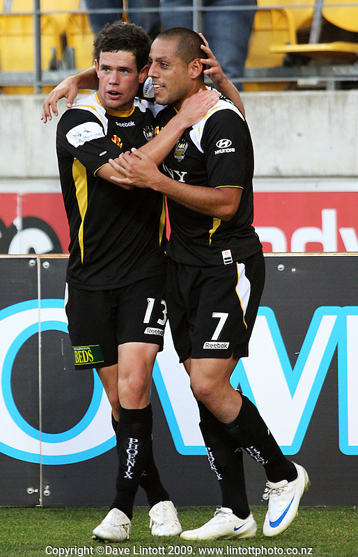 Troy Hearfield congratulates Leo Bertos on scoring Phoenix' first goal during the A-League match between Wellington Phoenix and Newcastle Jets at Westpac Stadium, Wellington, New Zealand on Sunday, 4 January 2009. Photo: Dave Lintott / lintottphoto.co.nz