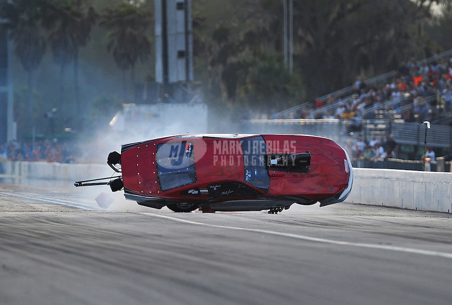 Mar. 9, 2012; Gainesville, FL, USA; NHRA pro mod driver Mike Janis crashes during qualifying for the Gatornationals at Auto Plus Raceway at Gainesville. Mandatory Credit: Mark J. Rebilas-