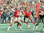 Washington, D.C. - January 8, 1984 -- San Francisco 49ers quarterback Joe Montana (16) looks for a receiver during the NFC Championship game against the Washington Redskins at RFK Stadium in Washington, D.C. on Sunday, January 8, 1984.  49ers left tackle Bubba Paris (77) provides some blocking for Montana. The Redskins won the game 24 - 21 to advance to Super Bowl XVIII.  <br /> Credit: Howard L. Sachs / CNP
