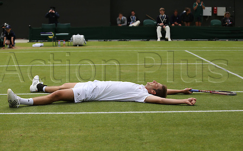 03.07.2012.   Wimbledon Championships 2012 AELTC London England. ITF Grand Slam Tennis Tournament. Richard Gasquet FRA  versus Florian Mayer. Florian Mayer ger lies on the court After his Victory Mayer won the match to go through to the quarter finals by a score of 6-3  6-1  3-6  6-2