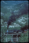 RGS #74 with RMRRC excursion southbound on Ophir High Line Bridge 46-D.  The flume for the Ames power plant is at right center.<br /> RGS  Ophir, CO  Taken by Kindig, Richard H. - 9/2/1951