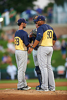 Burlington Bees pitching coach Jairo Cuevas (50) talks with relief pitcher Tyler Watson (28) and catcher Michael Barash (33) during a game against the South Bend Cubs on July 22, 2016 at Four Winds Field in South Bend, Indiana.  South Bend defeated Burlington 4-3.  (Mike Janes/Four Seam Images)
