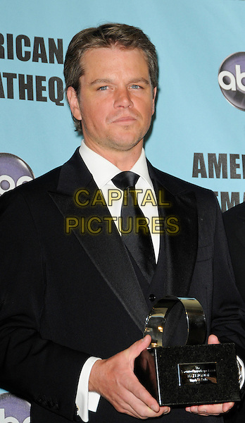 MATT DAMON .at the 24th Annual American Cinematheque Awards at the Beverly Hilton Hotel in Beverly Hills, California, USA, March 27th, 2010.  .half length black suit tie white shirt award trophy winner holding .CAP/ROT.©Lee Roth/Capital Pictures.