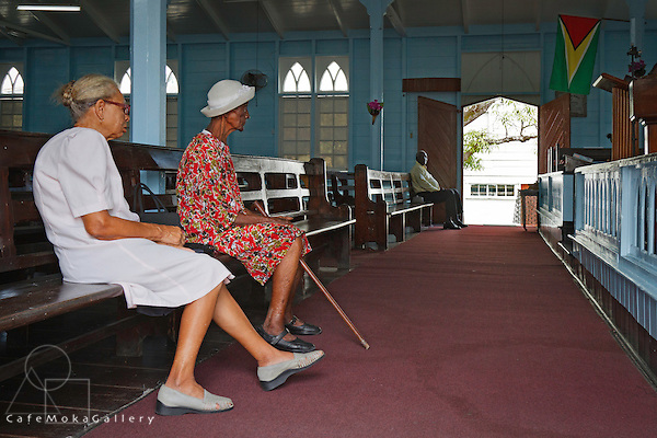 Senior ladies sitting on a pew at the Queenstown Moravian church in Georgetown, Guyana