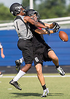 NWA Democrat-Gazette/JASON IVESTER --07/10/2015--<br /> Bentonville senior Elijah Barnett (left) knocks down a pass against Westmoore during the Southwest Elite 7-on-7 Tournament on Friday, July 10, 2015, at Rogers High School.