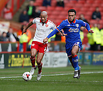Alex Baptiste of Sheffield Utd tackles Aaron Holloway of Oldham Athletic during the Sky Bet League One match at The Bramall Lane Stadium.  Photo credit should read: Simon Bellis/Sportimage
