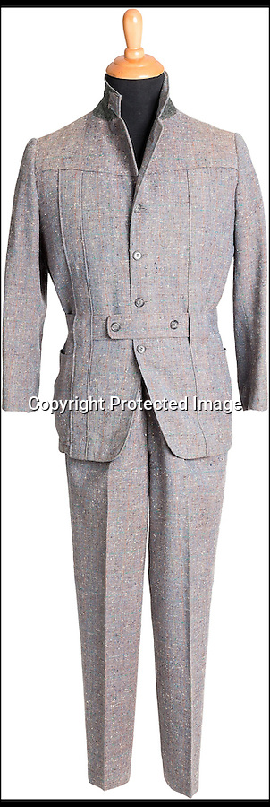 BNPS.co.uk (01202 558833)<br /> Picture: HeritageAuctions/BNPS<br /> <br /> ****Please use full byline****<br /> <br /> The water-stained grey woolen suit worn by Hollywood superstar Gene Kelly as he belted out the title number from hit musical Singin' in the Rain is for sale for £100,000.<br /> <br /> Kelly donned the two piece suit for the iconic centrepiece of the 1952 comedy in which he famously splashed through puddles twirling an umbrella during a downpour.<br /> <br /> Also for sale is Kelly's beige and navy outfit from the scene where Lockwood meets Cosmo Brown, played by co-star Donald O'Connor, on the set of a movie which is expected to fetch £4,000 at the Heritage Auctions sale on December 6.