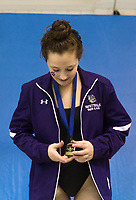 NWA Democrat-Gazette/CHARLIE KAIJO Fayetteville's Audrey McKinnon accepts her award for the girls 200 yard individual medley during a swim meet, Saturday, February 9, 2019 at the University of Arkansas HYPER pool in Fayetteville.