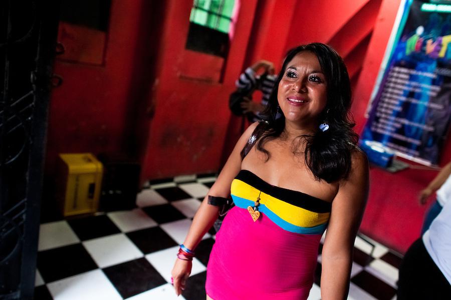 A Salvadorean girl, working as a prostitute, leaves a discotheque in San Salvador, El Salvador, 14 May 2011.