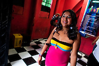 A Salvadorean girl, working as a prostitute, leaves a discotheque in San Salvador, El Salvador, 14 May 2011.