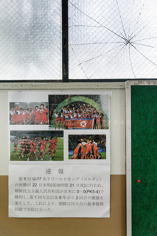 Osaka, Japan, November 25 2016 - In a staircase at East-Osaka Korean middle school (Higashi-Osaka chosen chugakko), a broken window and images of DPRK female soccer team winning the FIFA Under 17 Women's World Cup in 2016.<br /> 140 Korean schools are operated in Japan, including kindergartens and one university. The schools were initially funded by North Korea, but this money has dried up and the Japanese government has refused the Chosen Soren (General Association of Korean Residents in Japan with close ties to North Korea)&rsquo;s requests that it fund Korean schools.<br /> Professors at East-Osaka Korean middle school have not been paid for months.