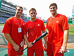 12 July 2008: Washington Redskins' place kicker Shaun Suisham (center) is flanked by teammates Reed Doughty (left) and Sam Hollenbach (right) after taking daytime batting practice with the Washington Nationals at Nationals Park in Washington, DC. The game that evening saw the Houston Astros defeat the Nationals 6-4 in the second game of their 3-game series...Mandatory Photo Credit: Ed Wolfstein Photo