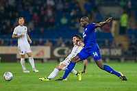 Pablo Hernandez of Leeds United and Sol Bamba of Cardiff City during the Sky Bet Championship match between Cardiff City and Leeds United at the Cardiff City Stadium, Cardiff, Wales on 26 September 2017. Photo by Mark  Hawkins / PRiME Media Images.