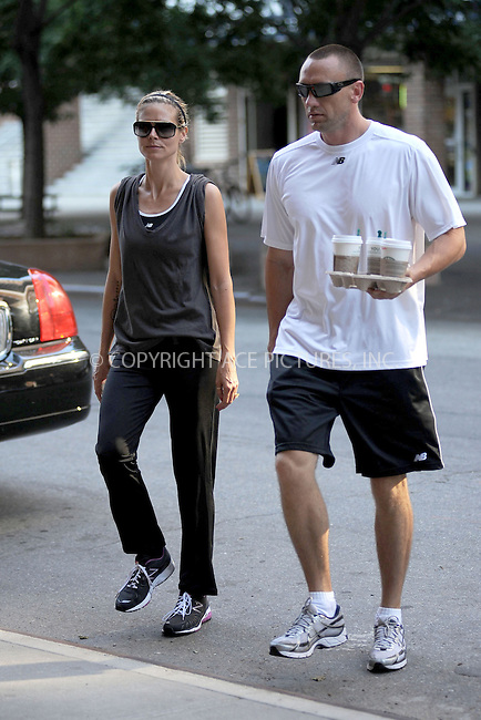 WWW.ACEPIXS.COM . . . . . .July 6, 2011...New York City... Heidi Klum returns to her hotel after her morning run on July 6, 2011 in New York City....Please byline: KRISTIN CALLAHAN - ACEPIXS.COM.. . . . . . ..Ace Pictures, Inc: ..tel: (212) 243 8787 or (646) 769 0430..e-mail: info@acepixs.com..web: http://www.acepixs.com .