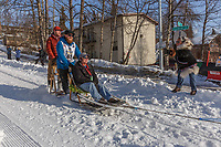Michael Baker on Cordova St. hill during the Anchorage start day of Iditarod 2018 on Cordova St. hill during the Anchorage start day of Iditarod 2019