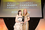 Wales Sport Awards 2013<br /> Sian Lewis receiving her award from Non Stanford.<br /> 09.11.13<br /> ©Steve Pope-SPORTINGWALES