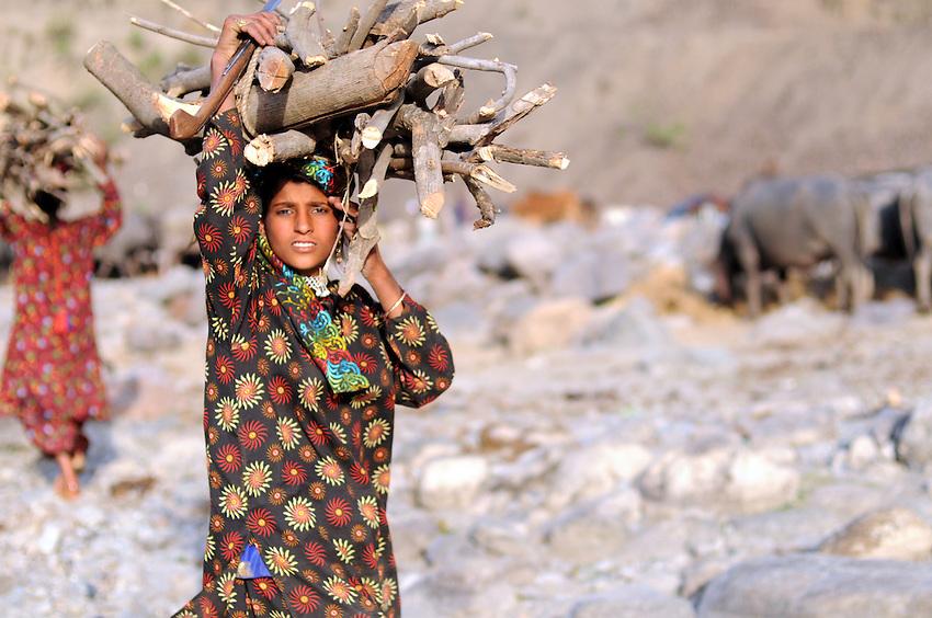 Mariam, 17, hauls firewood.