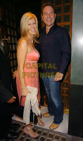 KATE GARRAWAY (GMTV) & RICHARD ARNOLD.At The Ivy Restaurant,.London, 17th August 2005.full length pink strappy dress high heel sandals shoes cream white cardigan denim jeans navy shirt black handbag couple.www.capitalpictures.com.sales@capitalpictures.com.©Capital Pictures