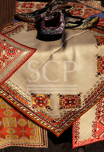 Sofia, Bulgaria. Embroidered table cloths and slippers.