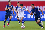 Javokhir Sidikov of Uzbekistan (C) is followed by Takashi Inui (R) and Muto Yoshinori of Japan (L) during the AFC Asian Cup UAE 2019 Group F match between Japan (JPN) and Uzbekistan (UZB) at Khalifa Bin Zayed Stadium on 17 January 2019 in Al Ain, United Arab Emirates. Photo by Marcio Rodrigo Machado / Power Sport Images