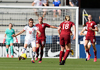 FRISCO, TX - MARCH 11: Patricia Guijarro #12 of Spain attempts to pass the ball with Jordan Nobbs #10 of England right behind her during a game between England and Spain at Toyota Stadium on March 11, 2020 in Frisco, Texas.