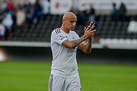 Saturday 4th  October 2014 Pictured: Jonjo Shelvey of Swansea City applauds fans as he leaves the field <br /> Re: Barclays Premier League Swansea City v Newcastle United at the Liberty Stadium, Swansea, Wales,UK