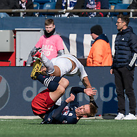 FOXBOROUGH, MA - MARCH 7: Johan Kappelhof #4 of Chicago Fire and Adam Buksa #9 of New England Revolution collision during a game between Chicago Fire and New England Revolution at Gillette Stadium on March 7, 2020 in Foxborough, Massachusetts.