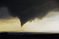 A cone-shaped funnel descends from a large wall cloud near Brice in the Texas Panhandle in late March.