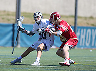 Washington, DC - March 31, 2018: Georgetown Hoyas Austin McDonald (10) gets hit by Denver Pioneers Zach Runberg (25) during game between Denver and Georgetown at  Cooper Field in Washington, DC.   (Photo by Elliott Brown/Media Images International)
